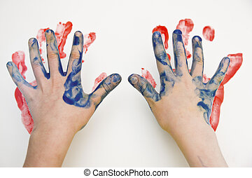 Fingerpaint - A child painting with his hands and fingers