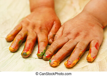 Toddler fingerpainting - Young child painting with hands -...