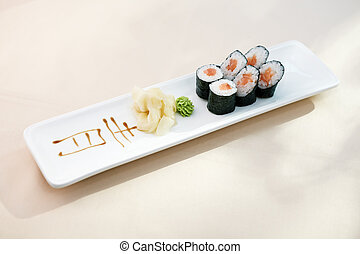 Tuna maki with wasabi and ginger on a plate