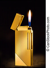 Elegant golden gas lighter against a dark background