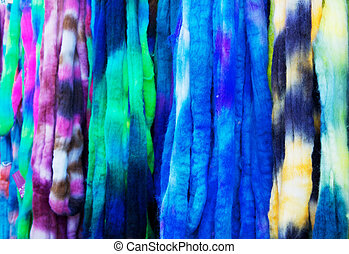 Dyed wool yarn - Blue, violet, yellow, green, and white...