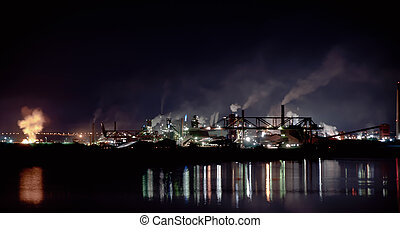 fumes from steel mill in the harbour - Smoke bellows from a...
