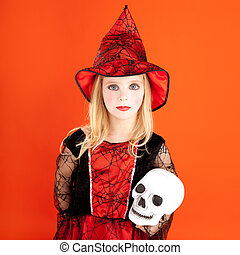 Halloween kid girl costume on orange background