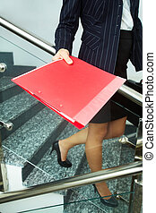 Secretary with folder - Close-up of businesswoman with red...