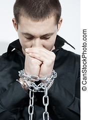 chained hands  - Man with a chained hands.