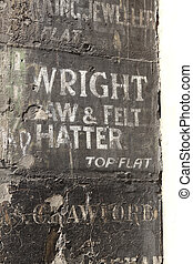 Very old name plates painted on wall in Edinburgh -...