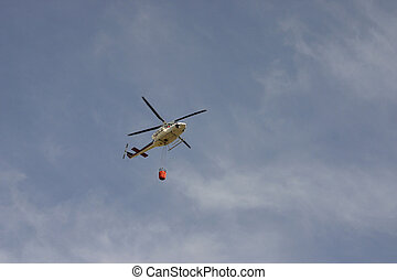Fire rescue helicopter with bucket