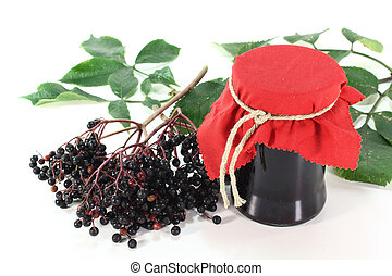 Elderberry jelly with elderflower berries and leaves on a...