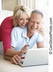 Senior couple on her laptop computer