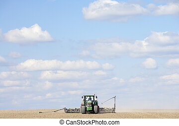 Tractor Planting Seed In Field