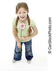 Studio Portrait of Smiling Girl Holding Flower