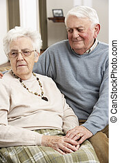 Senior Man Consoling Wife At Home