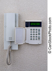 touchpanel to activate the alarm located besides the...