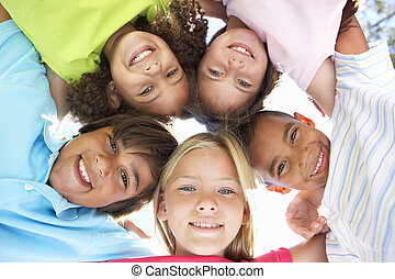 Group Of Children Looking Down Into Camera