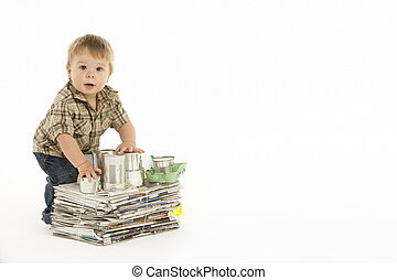 Young Boy Recycling In Studio