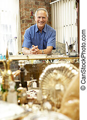 Male antique shop proprietor