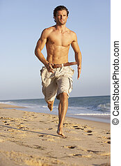 Young Man Running Along Summer Beach
