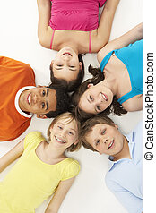 Overhead View Of Five Young Children In Studio