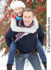Senior Couple Outside In Snowy Landscape