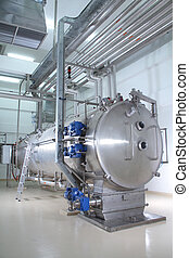 machinery in a pharmaceutical production plant - Modern...