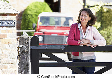 Farmers Wife Looking Over Farm Gate