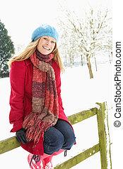 Woman Standing Outside In Snowy Landscape