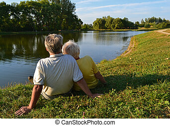 Retired couple relaxing - A senior couple sitting and...