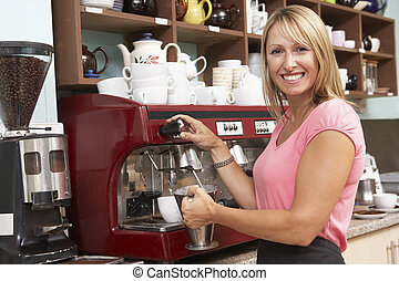 Woman Making Coffee In Caf