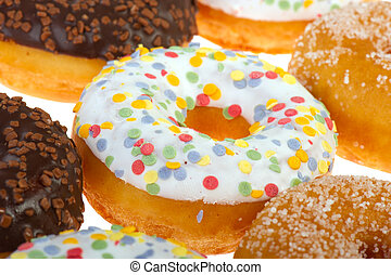 White donuts with confetti
