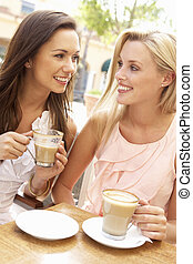 Two Young Women Enjoying Cup Of Coffee In Caf?