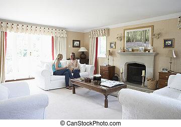 Two Women Relaxing In Lounge