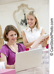 Women looking at laptop together