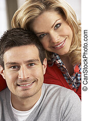 Portrait Of Happy Young Couple At Home