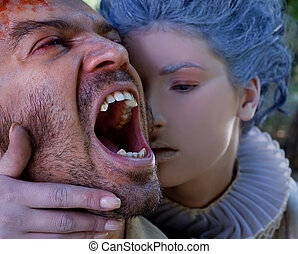 Medieval woman embracing male vampire - Close-up of medieval...