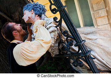 Male vampire attacking woman