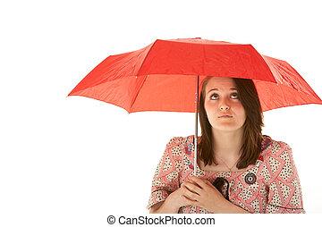 Studio Shot Of Teenage Girl Standing Under Red Umbrella