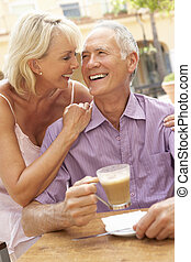 Senior Couple Enjoying Coffee And Cake In Caf?