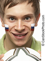 Young Male Football Fan With Slovakian Flag Painted On Face