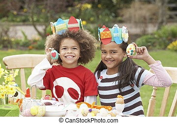 Children Painting Easter Eggs In Gardens