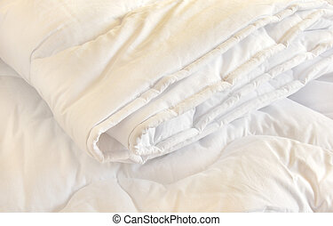 White duvet - white folded cotton duvet background