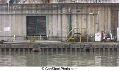 Forklift. Industrial dock. - A forklift passes on an...