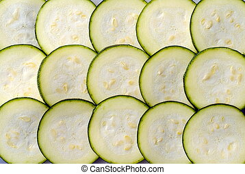 slices of courgette, one upon the others, as background