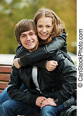 Smiling young people couple outdoors - Two young people...