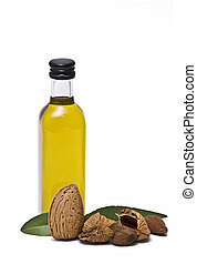 Bottle of almond oil. - Almonds and a bottle of almond oil...
