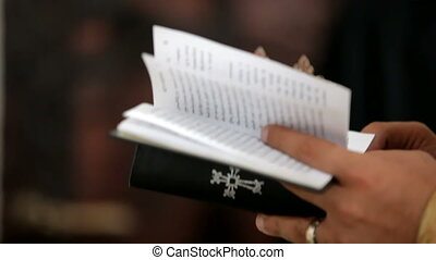 Priest reads the bible - Holy father holds a church ritual.