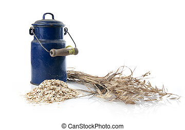 oatmeal and flagon of milk on white background