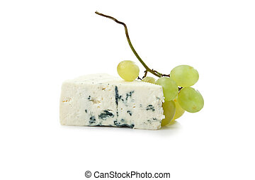 wedge of gorgonzola decorated with grapes isolated on white...