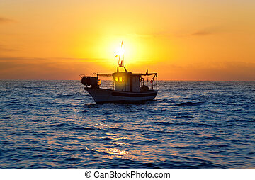 fishing boat in sunrise at Mediterranean sea traditional...