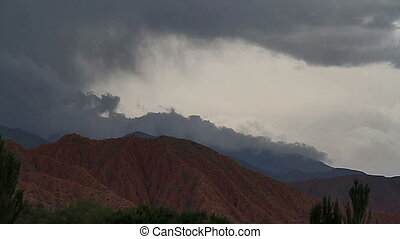 Current clouds - The clouds flow down the slopes of the...