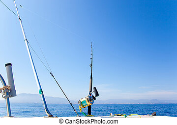 fishing boat trolling with outrigger gear